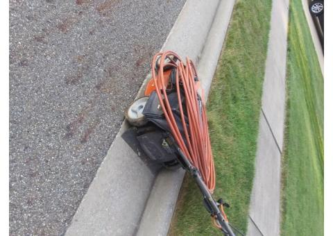 Lawn mower and telecommunication wire