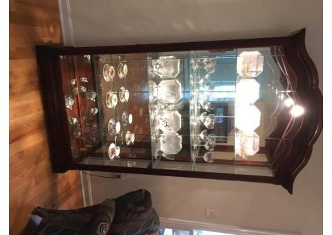 Howard Miller curio,cherry wood, lit, and beveled glass front, like new